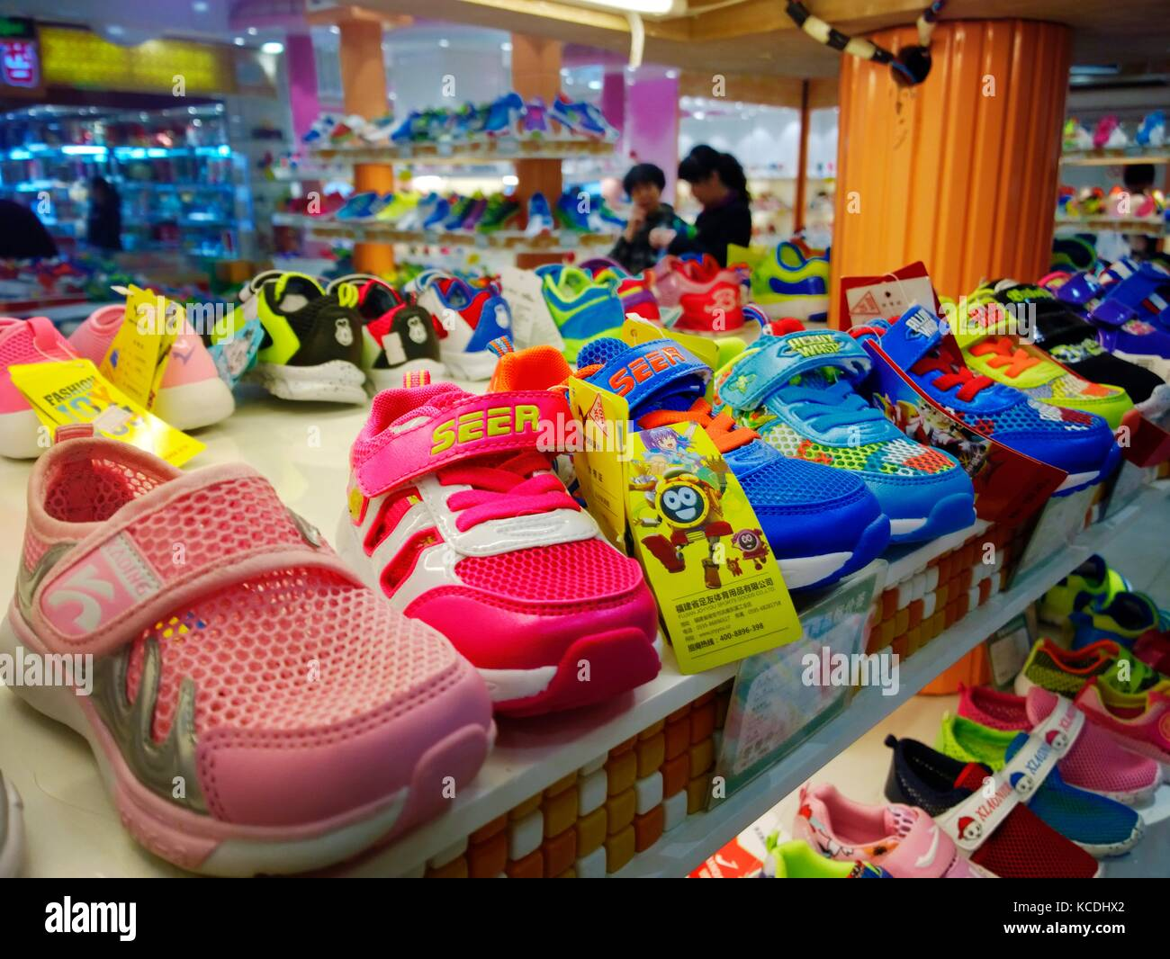 66591dcdd49ac5 Colourful childrens infants plastic shoes trainers on display in shoe store  shop in the Chinese city