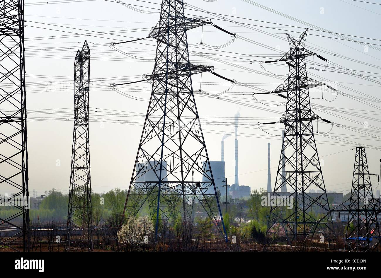 Chinese coal powered electricity generating power station on north side of city of Taiyuan, China. Cooling towers - Stock Image