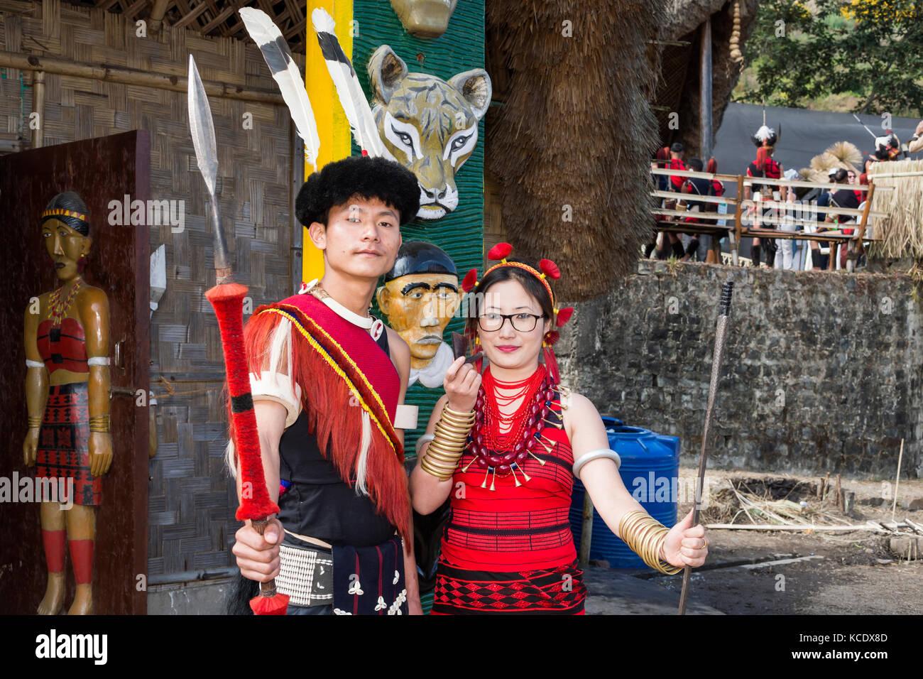 Couple of Naga tribal people in traditional clothing, Kisima Nagaland Hornbill festival, Kohima, Nagaland, India - Stock Image