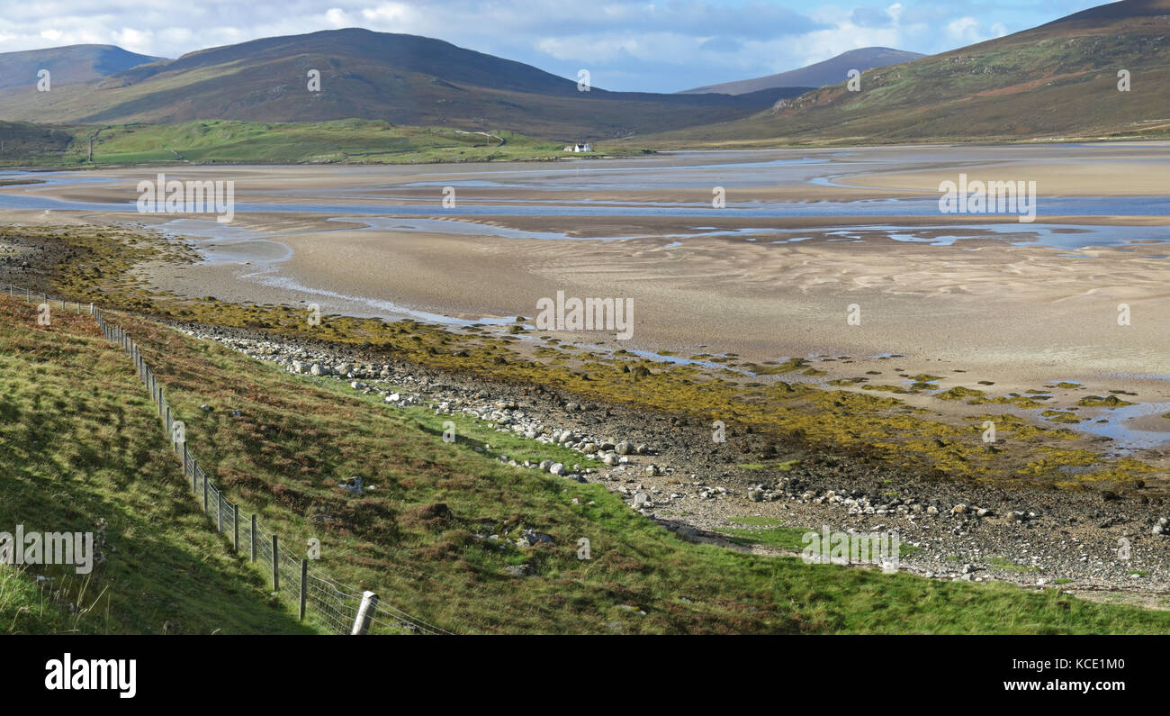 Early morning view of the Kyle of Durness, northen Scotland. View south at Low tide showing sand flats and isolated - Stock Image