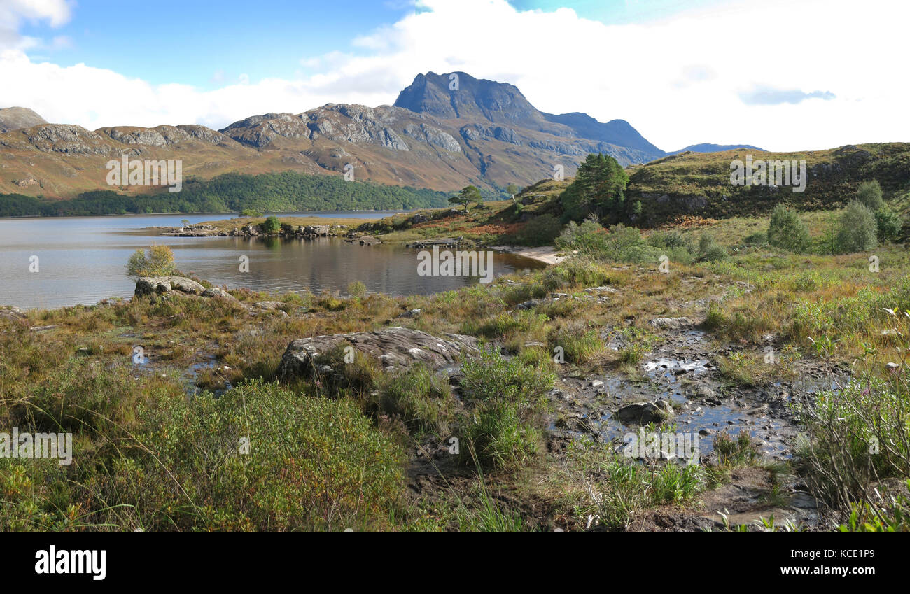 View southwest across Loch Maree to the peak of Slioch in the Scottish Highlands, UK. Shows autumn landscape. - Stock Image
