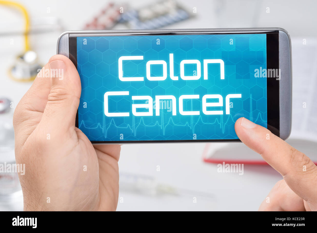 Smartphone with the text Colon Cancer on the display - Stock Image