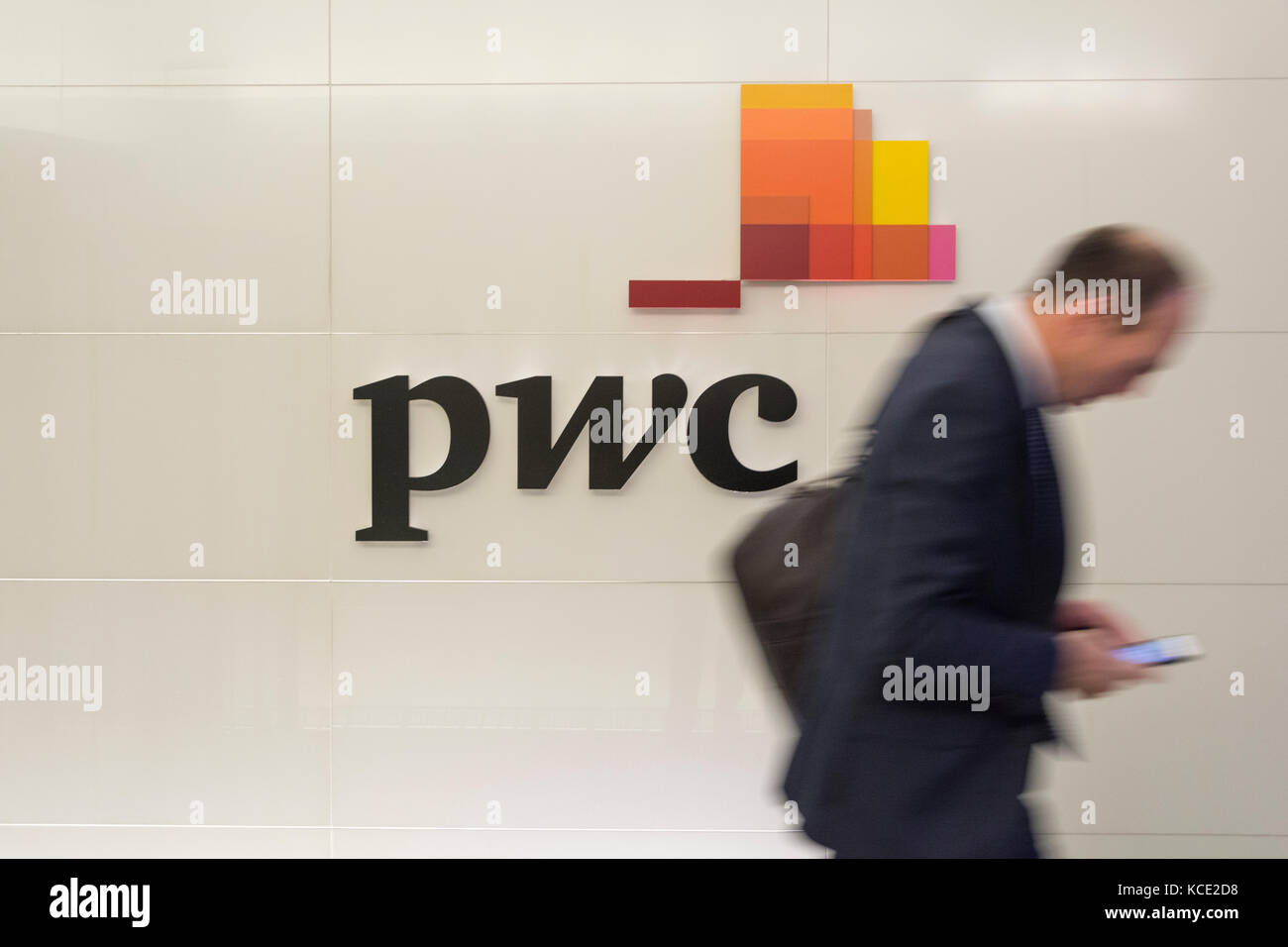 Staff leaving Price Waterhouse Coopers offices on the Embankment, London, UK - Stock Image