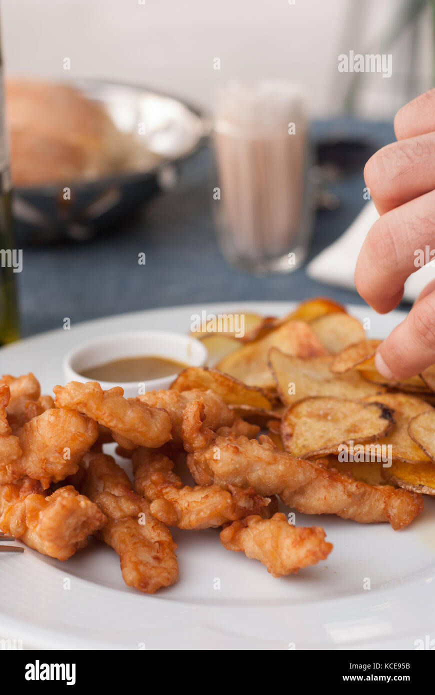 Fresh fried chicken fingers in a plate - Stock Image