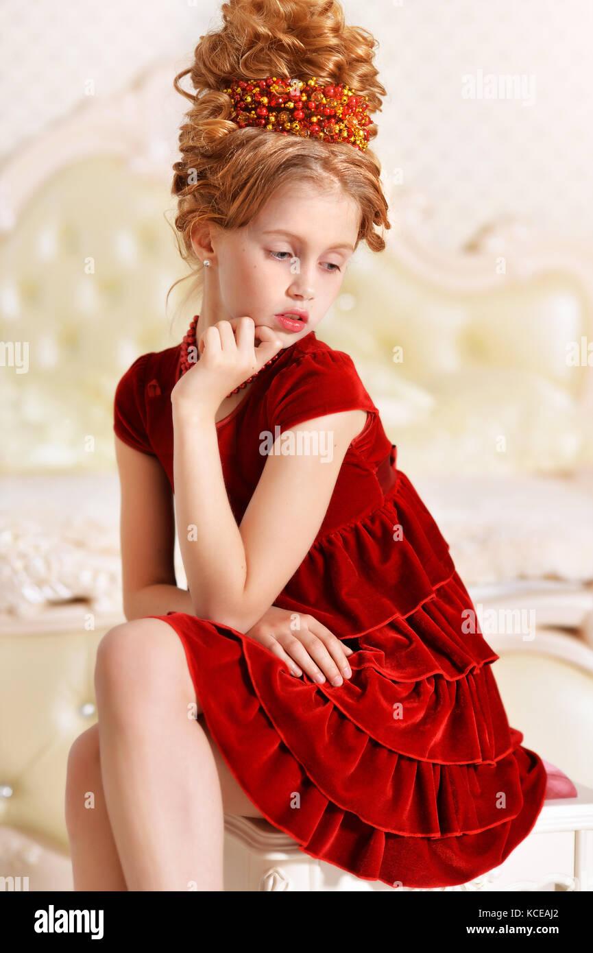 cd0ecac0ea3a little girl in red velvet dress Stock Photo: 162584858 - Alamy