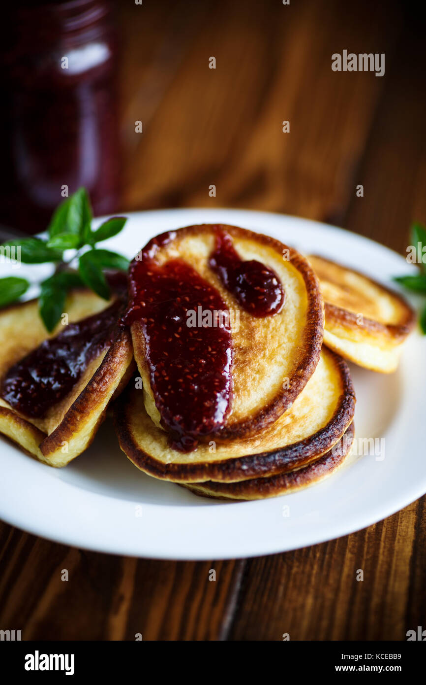 sweet pancakes with raspberry jam - Stock Image
