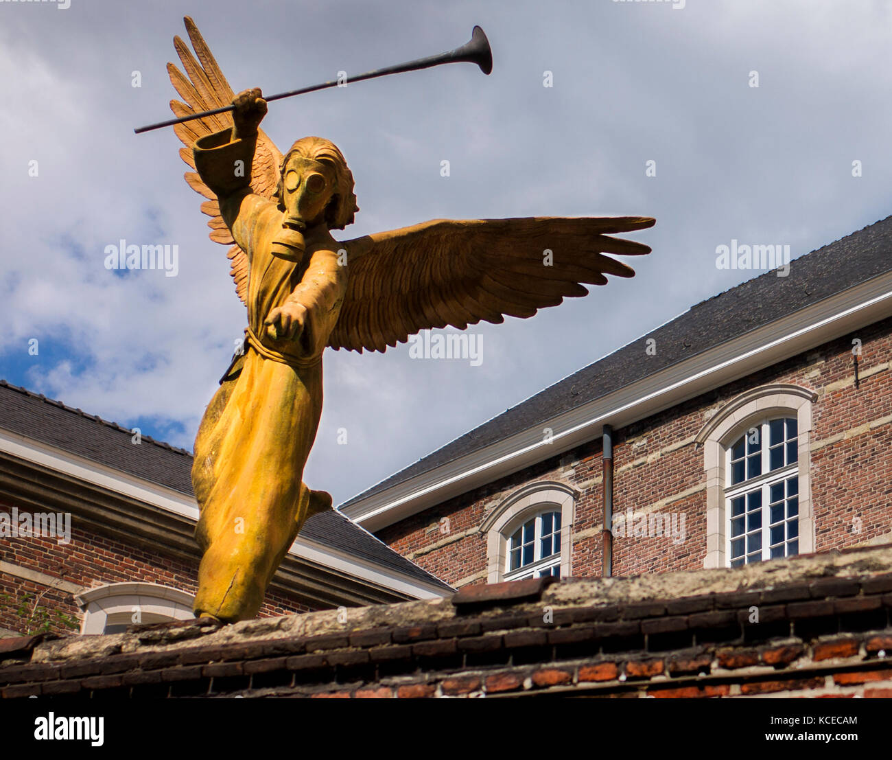 statue of one of the seven angels of the apocalypse wearing a gas mask Ghent Belgium - Stock Image