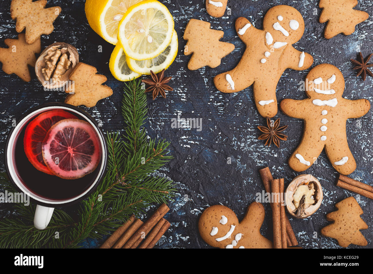 Mulled wine with lemon slices in white rural mug  on rustic table , top view - Stock Image