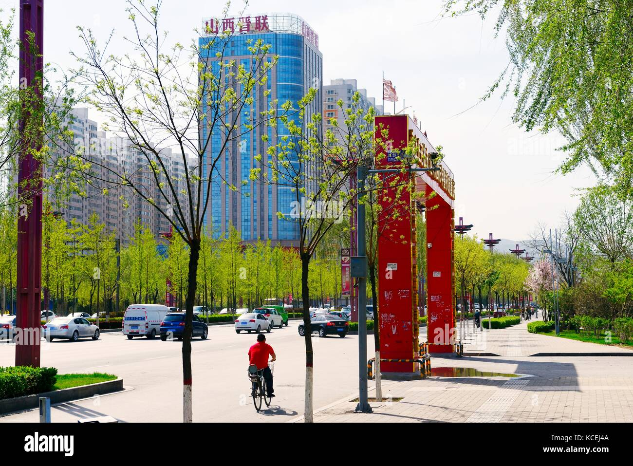 Inner city redevelopment Taiyuan city, Shanxi Province, China. Changfeng West Street. New highway in modernised - Stock Image