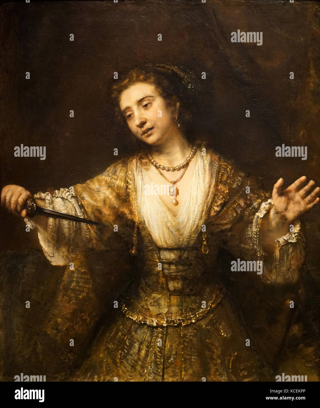 Painting titled 'Lucretia' by Rembrandt (1606-1669) a Dutch draughtsman, painter and printmaker. Dated 17th - Stock Image