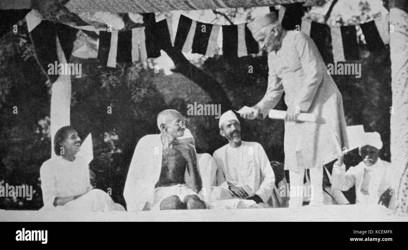 Mahatma Gandhi at a meeting in Allahabad, presided over by Motilal Nehru (standing). Mohandas Gandhi (1869 – 1948) - Stock Image