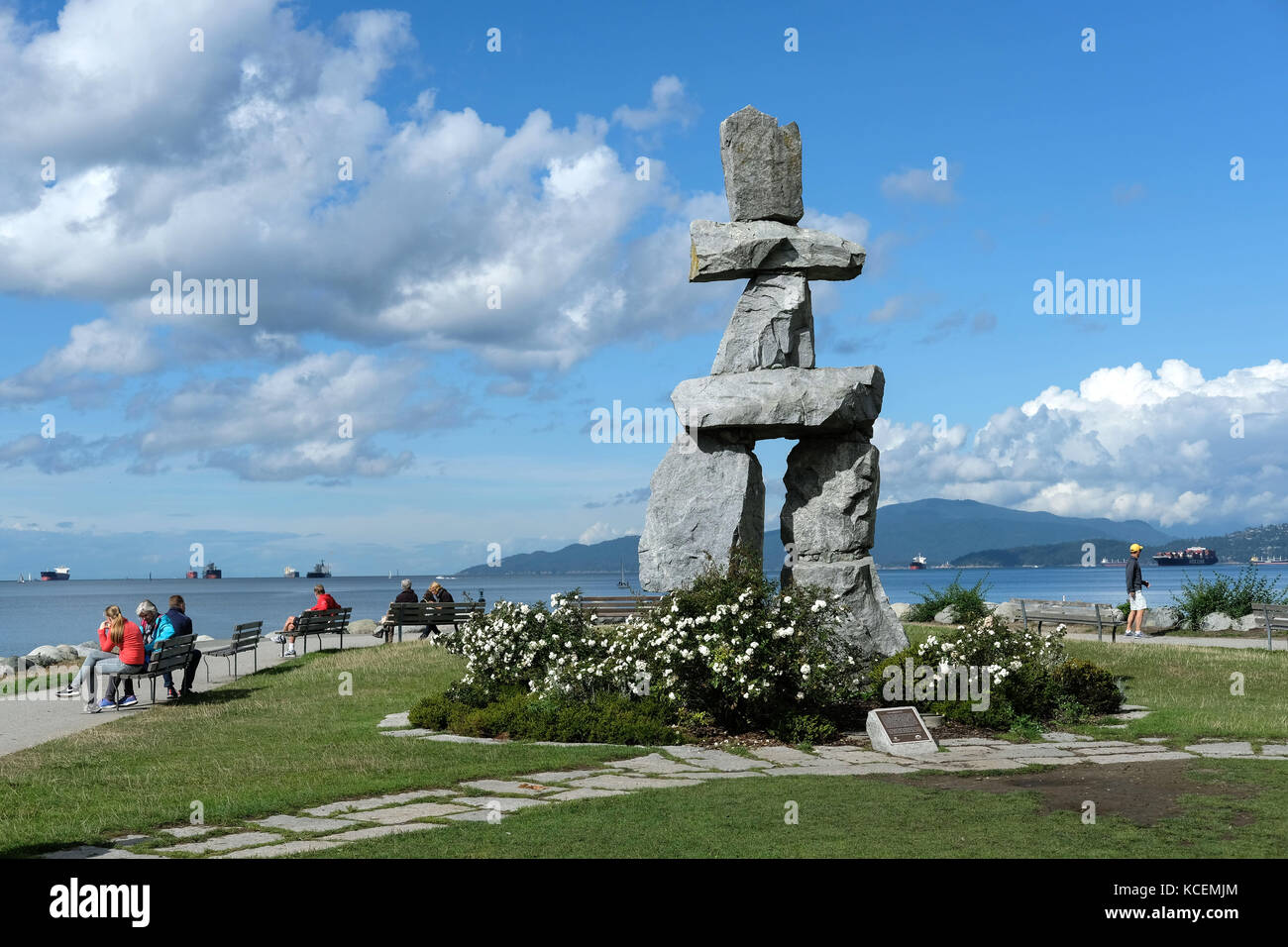 Inukshuk, a human-made stone sculpture which is an ancient symbol of the Inuit culture. The sculpture sits along - Stock Image