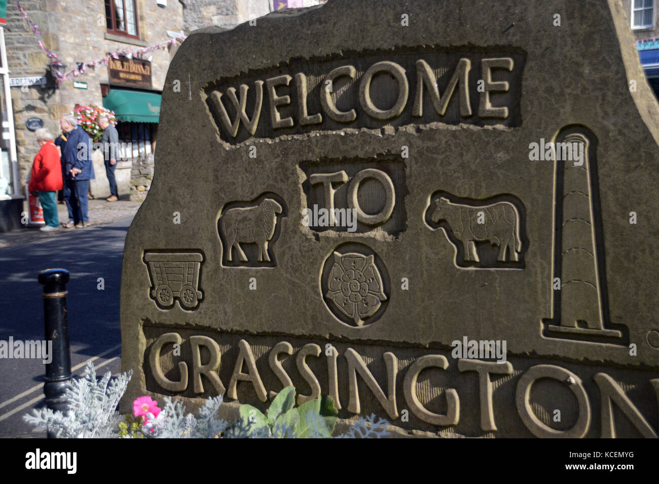 Stone Carved Welcome to Grassington Village Sign on the Dales Way Long Distance Footpath in Wharfedale, Yorkshire Dales National Park, England, UK. Stock Photo