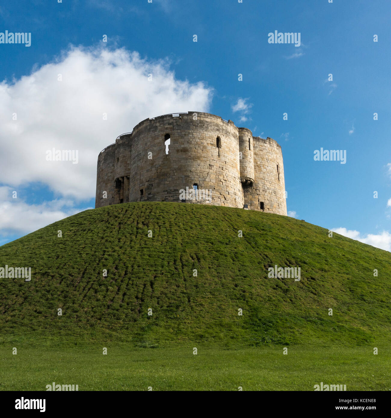 Sunny Autumn Day With Bright Blue Sky, Over Well Known Historic Landmark,  Cliffordu0027s Tower High On Grassy Mound   York, North Yorkshire, England, UK.