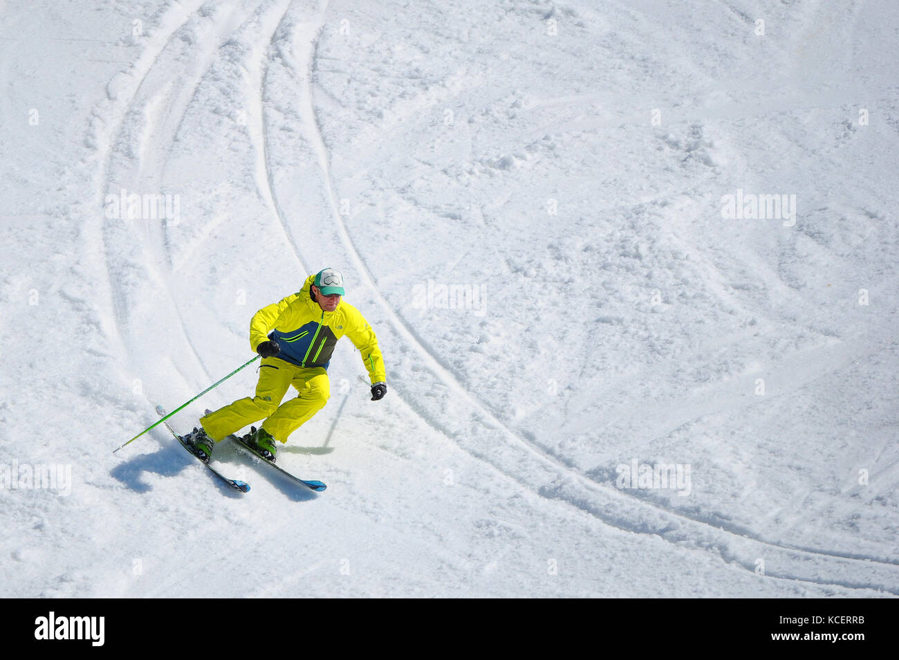 A skier carves a turn photographed from above. Stock Photo