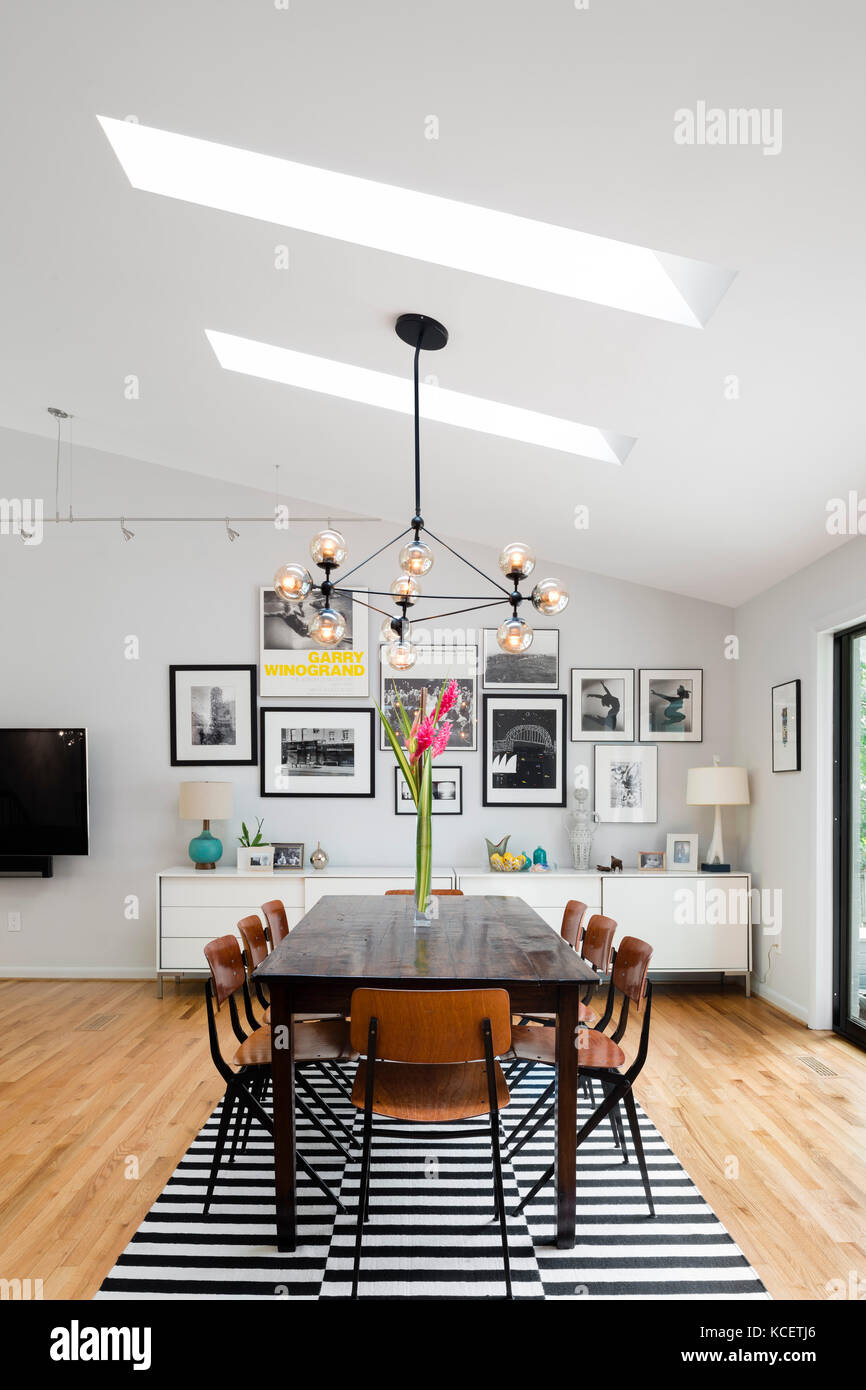 Dining area featuring skylights, in the main living room with open ...