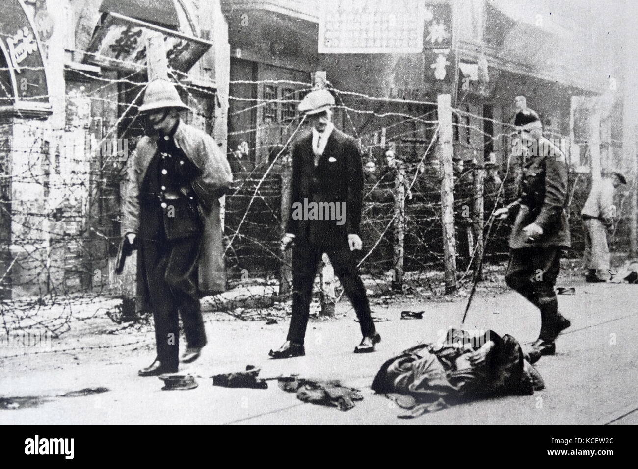 British consular officials inspect scene of Massacre in Canton, China 1925.On June 21, 1925, workers in Hong Kong - Stock Image