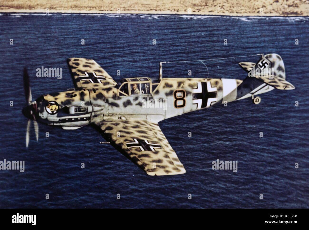 Photograph of a Messerschmitt Bf 109, a German World War II fighter aircraft, flying over Africa. Dated 20th Century - Stock Image
