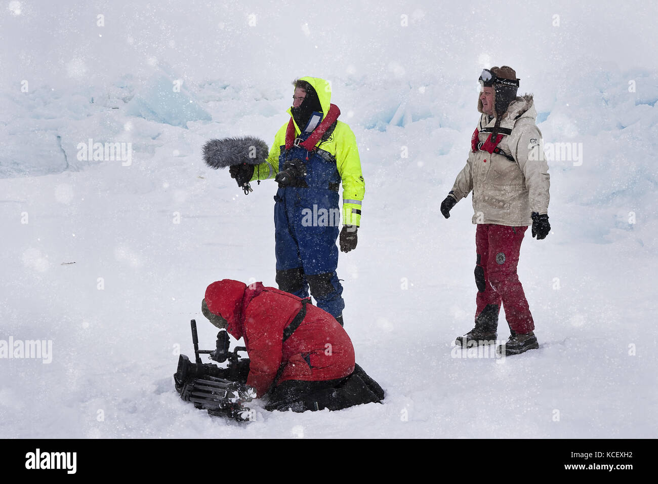BBC film crew in Antarctica for Frozen Planet TV series in snow storm at Snow Hill emperor colony Stock Photo