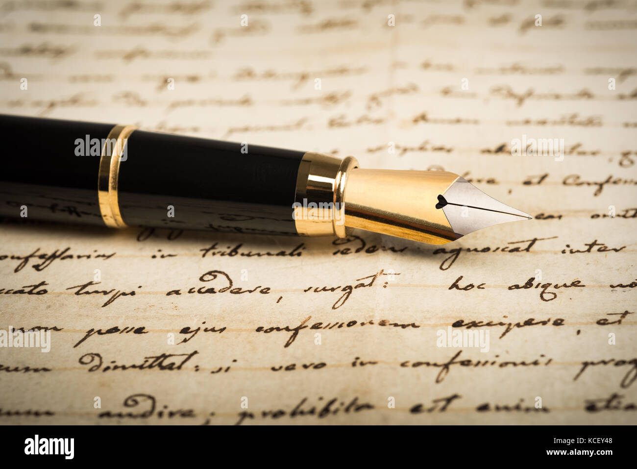 Fountain pen on letter background - Stock Image