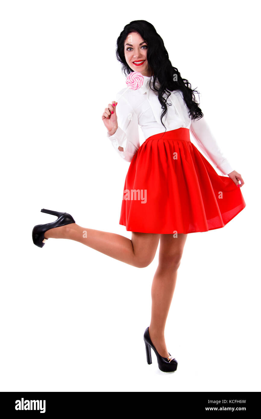 6e8c58178c Beautiful young woman in a white blouse and a short red skirt isolated over  white background