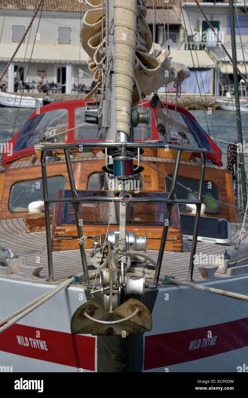 the bows of a classic cruising yacht with roller reefing jib or foresail moored in a marina in the Mediterranean - Stock Image