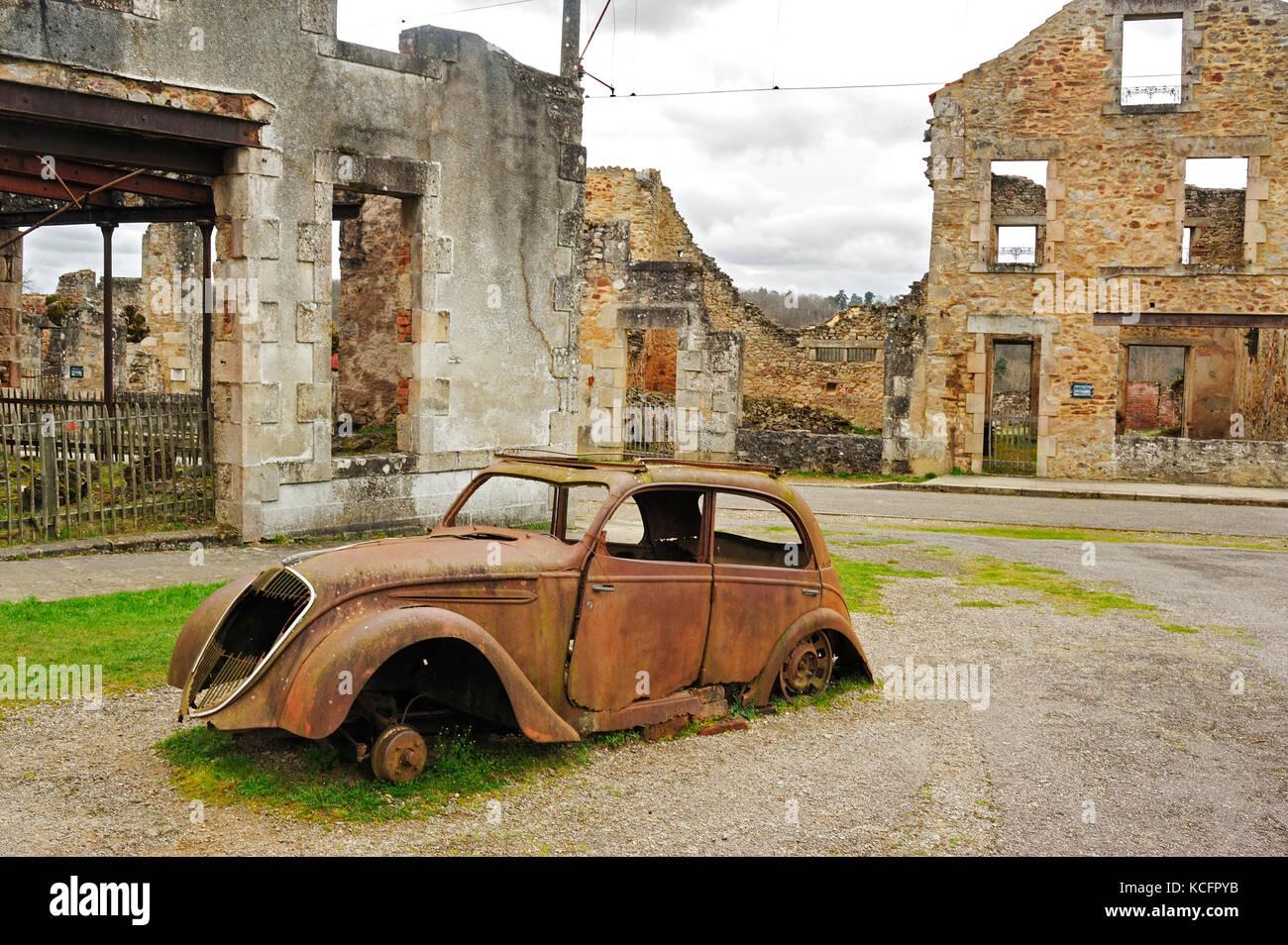 Peugeot 202 car ruins, Oradour-sur-Glane, Haute-Vienne Department, Limousin, France - Stock Image