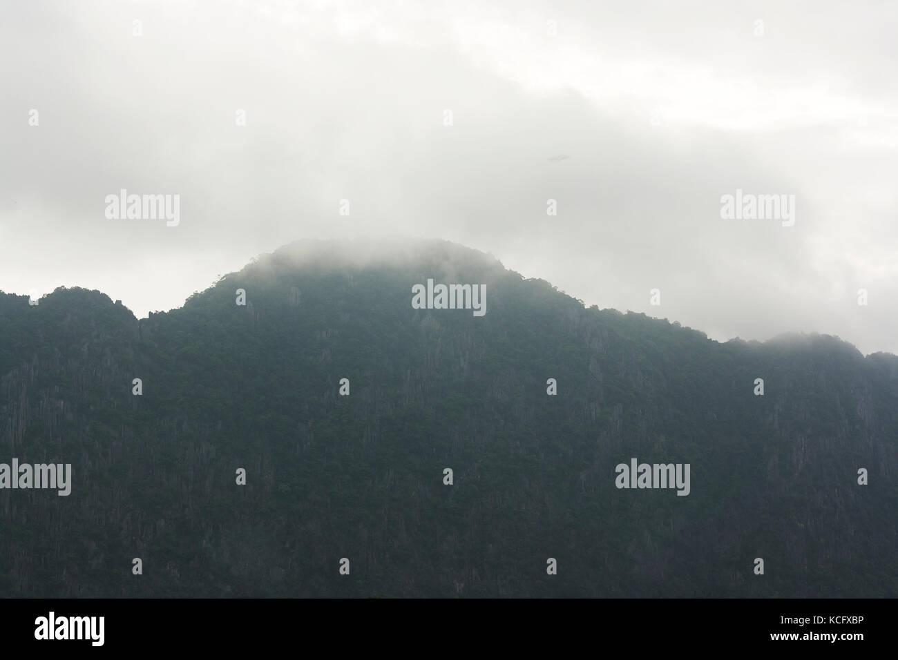 rain cloud over mountain - Stock Image