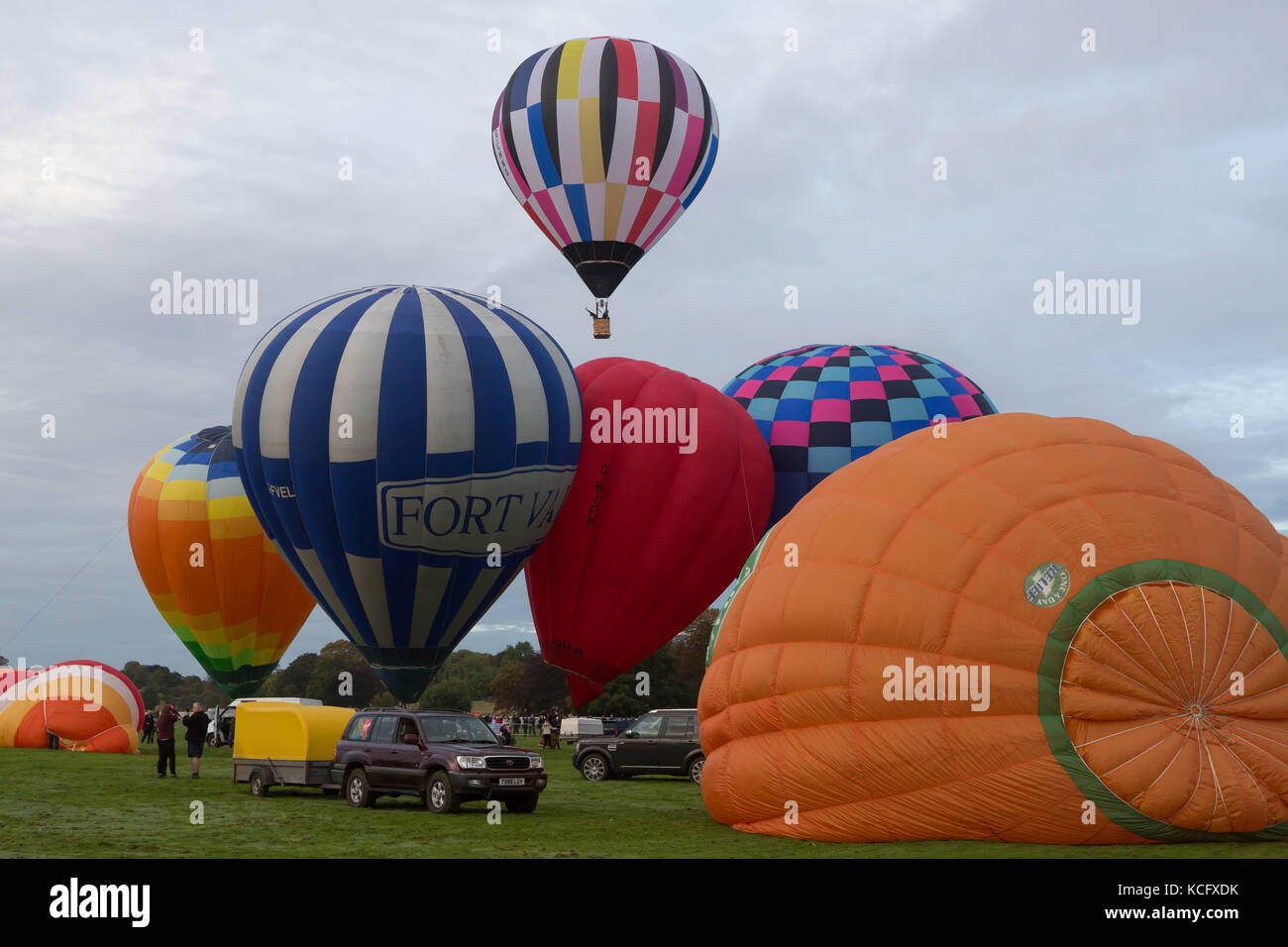 Hot air balloons being inflated and taking off from The Knavesmire York, United Kingdom Stock Photo