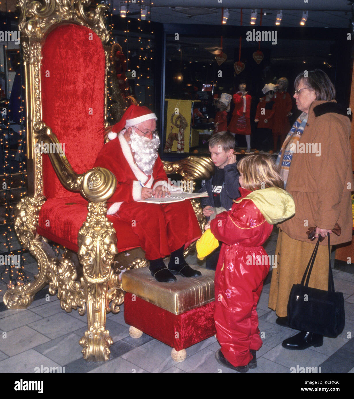 SANTA CLAUS at a shopping center receives wishes from children 2010 - Stock Image