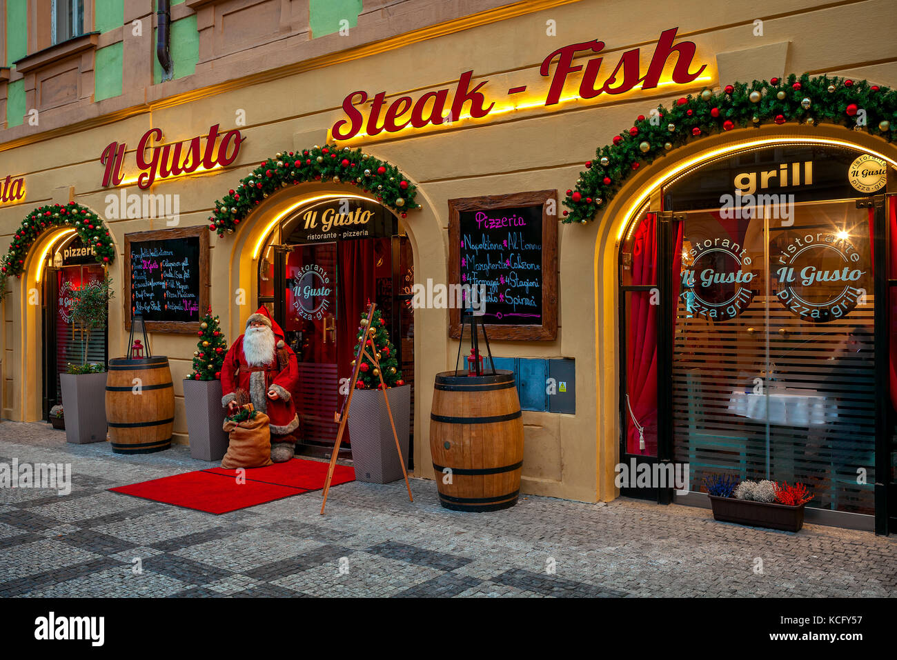 PRAGUE, CZECH REPUBLIC - DECEMBER 10, 2016: Decorative Santa Clause at the entrance to Christmas decorated restaurant - Stock Image