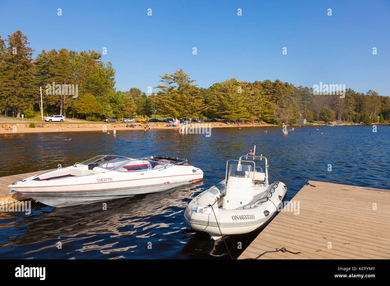 Two boats docked at Canada,Ontario,Huntsville,Dwight, Dwight Beach sommer playground in Ontario's North in Cottage - Stock Image