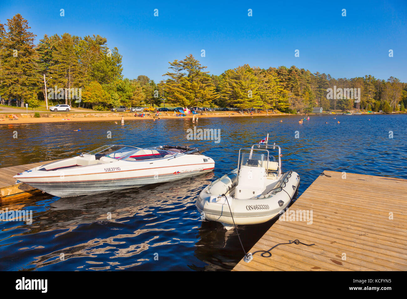 Boats docked in Canada,Ontario,Huntsville,Dwight, Dwight Beach sommer playground in Ontario's North in Cottage - Stock Image