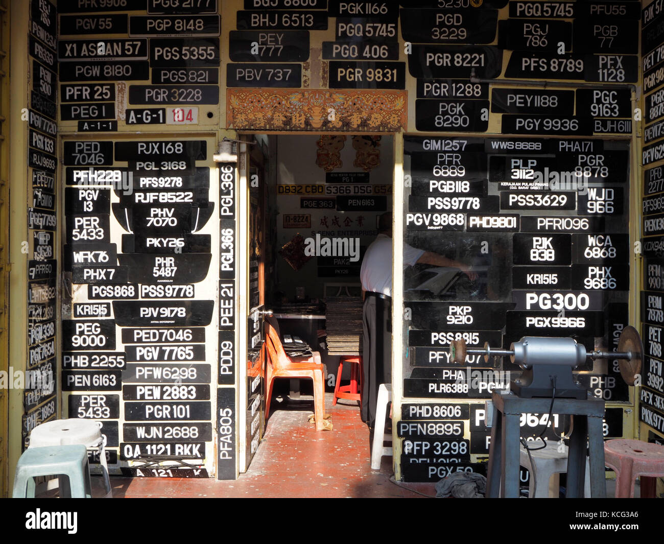 A shop making vehicle number plates in Penang, Malaysia. - Stock Image