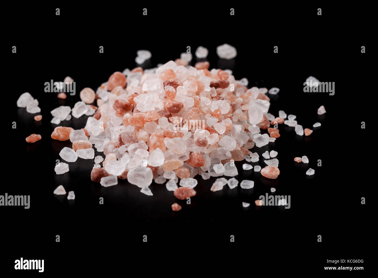 Pink Himalayan Salt Crystals on Black Background - Stock Image