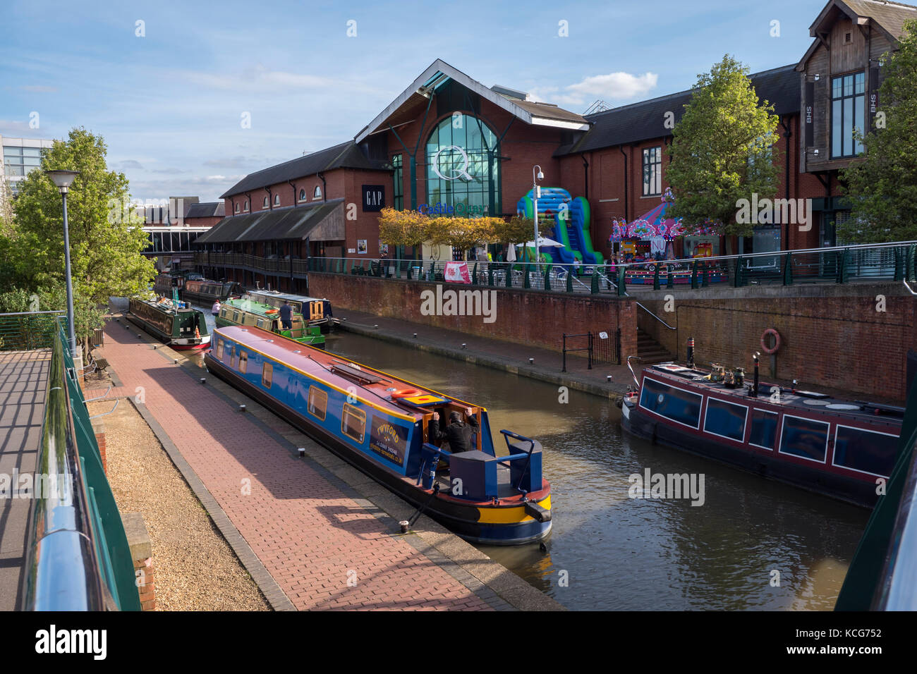 Canal boats moored on the Oxford Canal at Castle Quay Shopping Centre Banbury Oxfordshire England - Stock Image