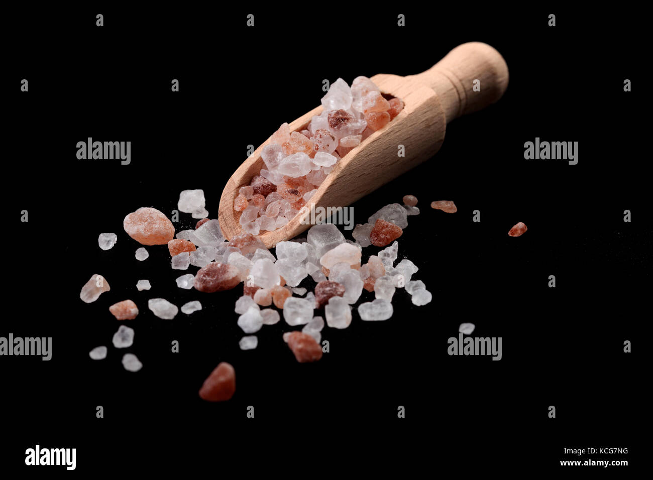 Wood Spice Spoon With Himalayan Salt on Black Background - Stock Image