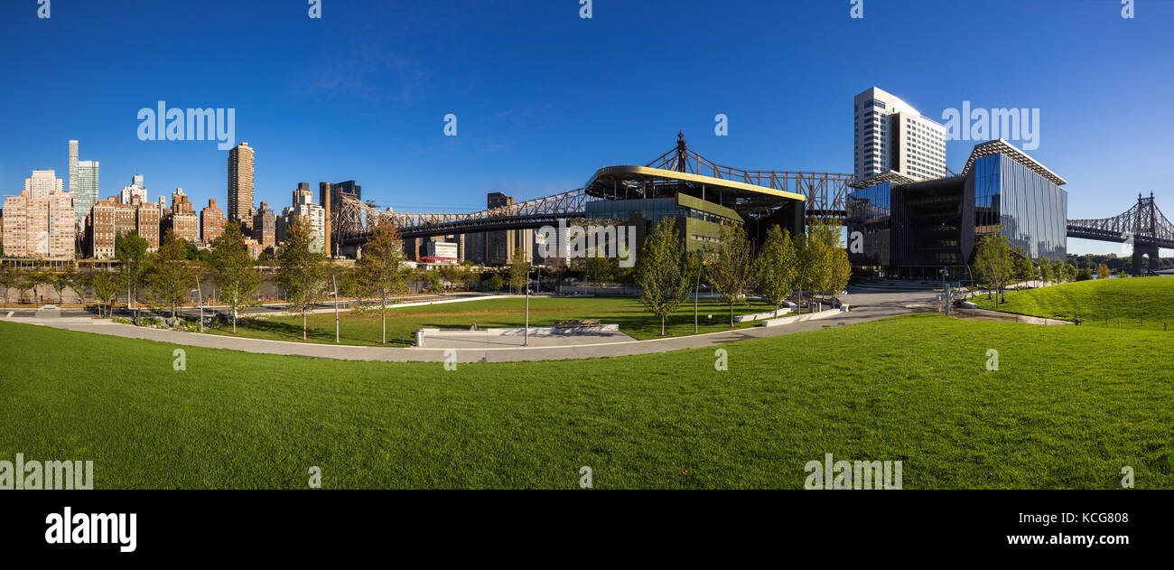 Summer panoramic view of the Cornell Tech campus on Roosevelt Island with the Queensboro Bridge. New York City - Stock Image