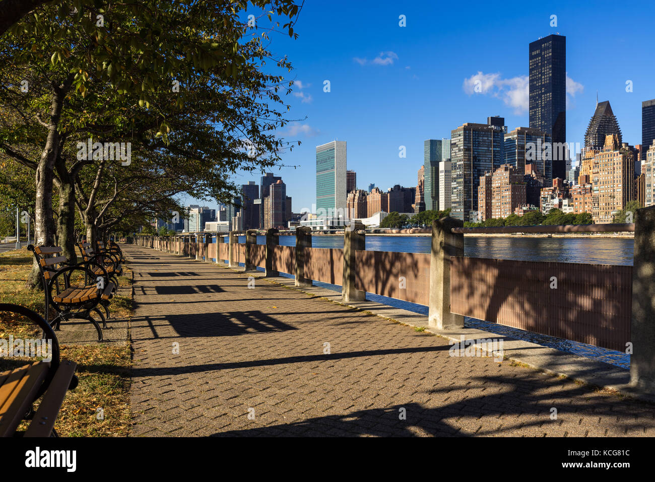 Morning view of Manhattan Midtown East skyscrapers from Roosevelt Island with the East River. New York City - Stock Image