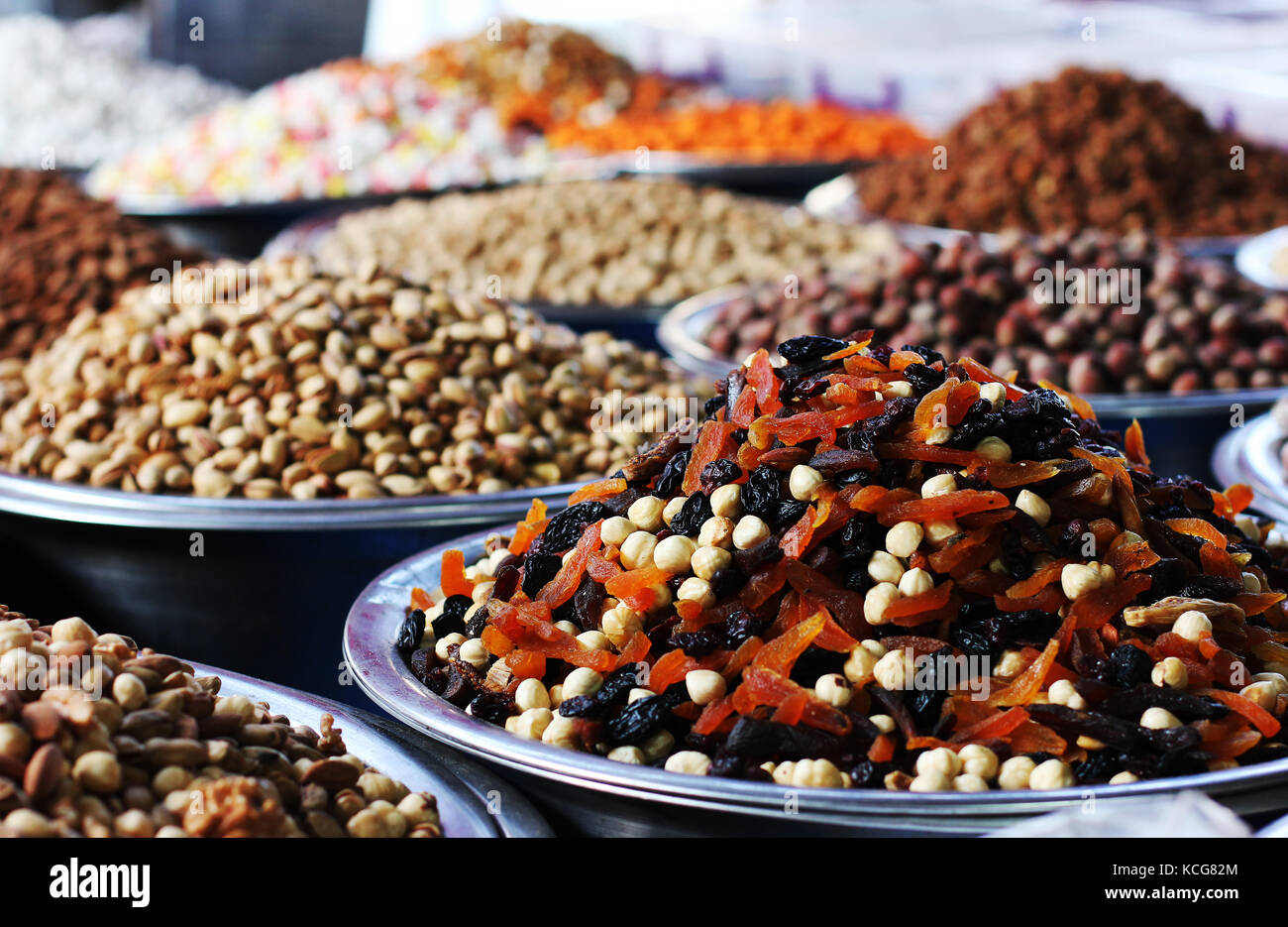 Mixture of dried apricots, prunes and hazelnuts. Dried fruits at east market - Stock Image