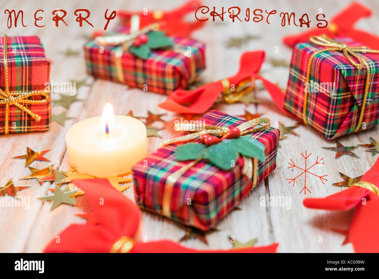 christmas gift boxes with red ribbons and gold stars stock image