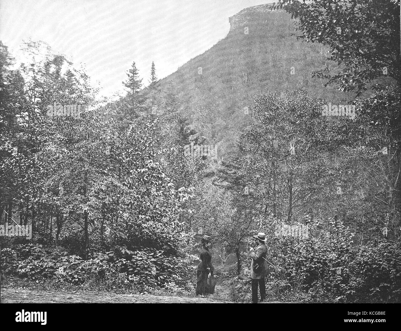 United States of America, New Hampshire, Man and woman standing in front of the Franconia Mountains, the upper part - Stock Image