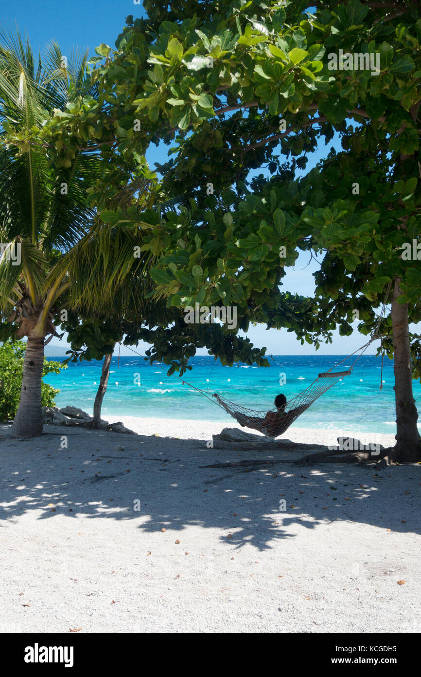 Philippines beach, Cebu island - a tourist relaxing in a hammock on holiday, Cebu, Philippines, Asia - Stock Image