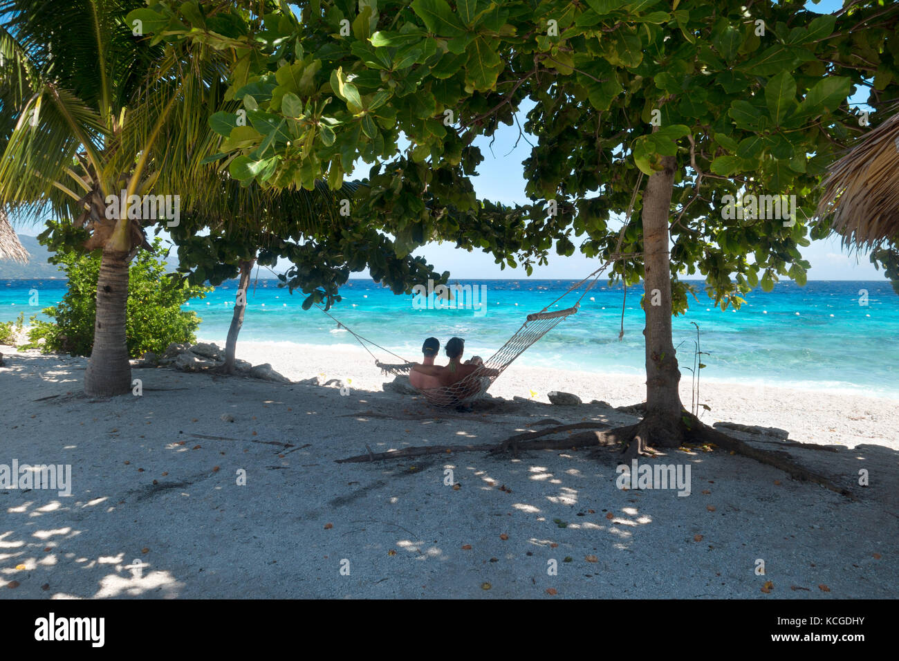 Philippines beach, Cebu island - couple relaxing in a hammock on honeymoon holiday, Cebu, Philippines, Asia - Stock Image