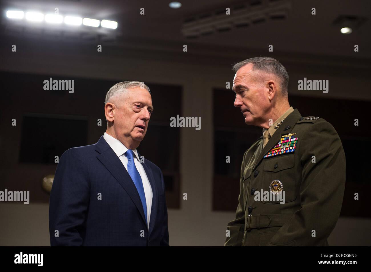 Secretary of Defense Jim Mattis speaks with U.S. Marine Corps Gen. Joseph F. Dunford, Jr., chairman of the Joint Chiefs of Staff Stock Photo