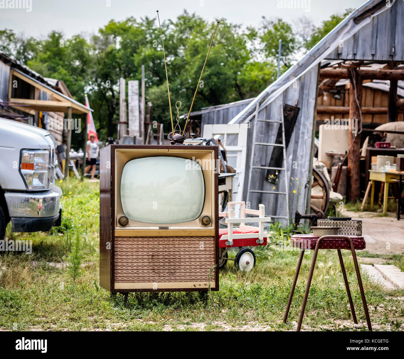 A vintage television and other items at an outdoor Flea Market, Manitoba, Canada. - Stock Image