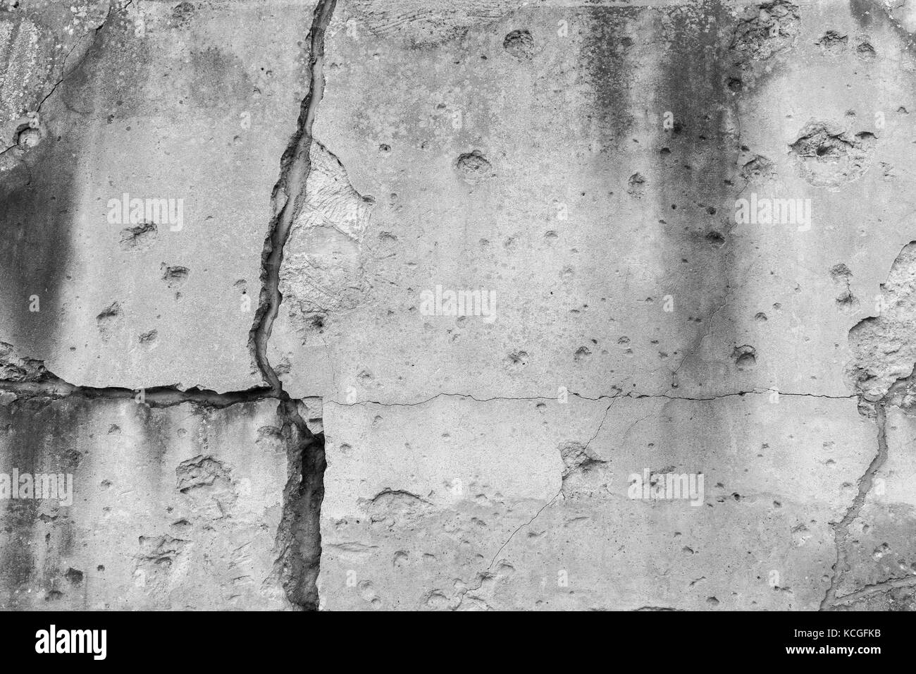 Old, damaged and cracked wall with real bullet holes from World War II in Gdansk, Poland. Background texture in - Stock Image