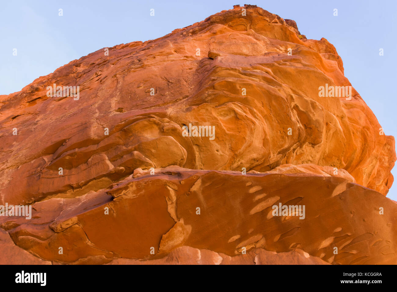 An orange colored rock formation in Nevada. - Stock Image