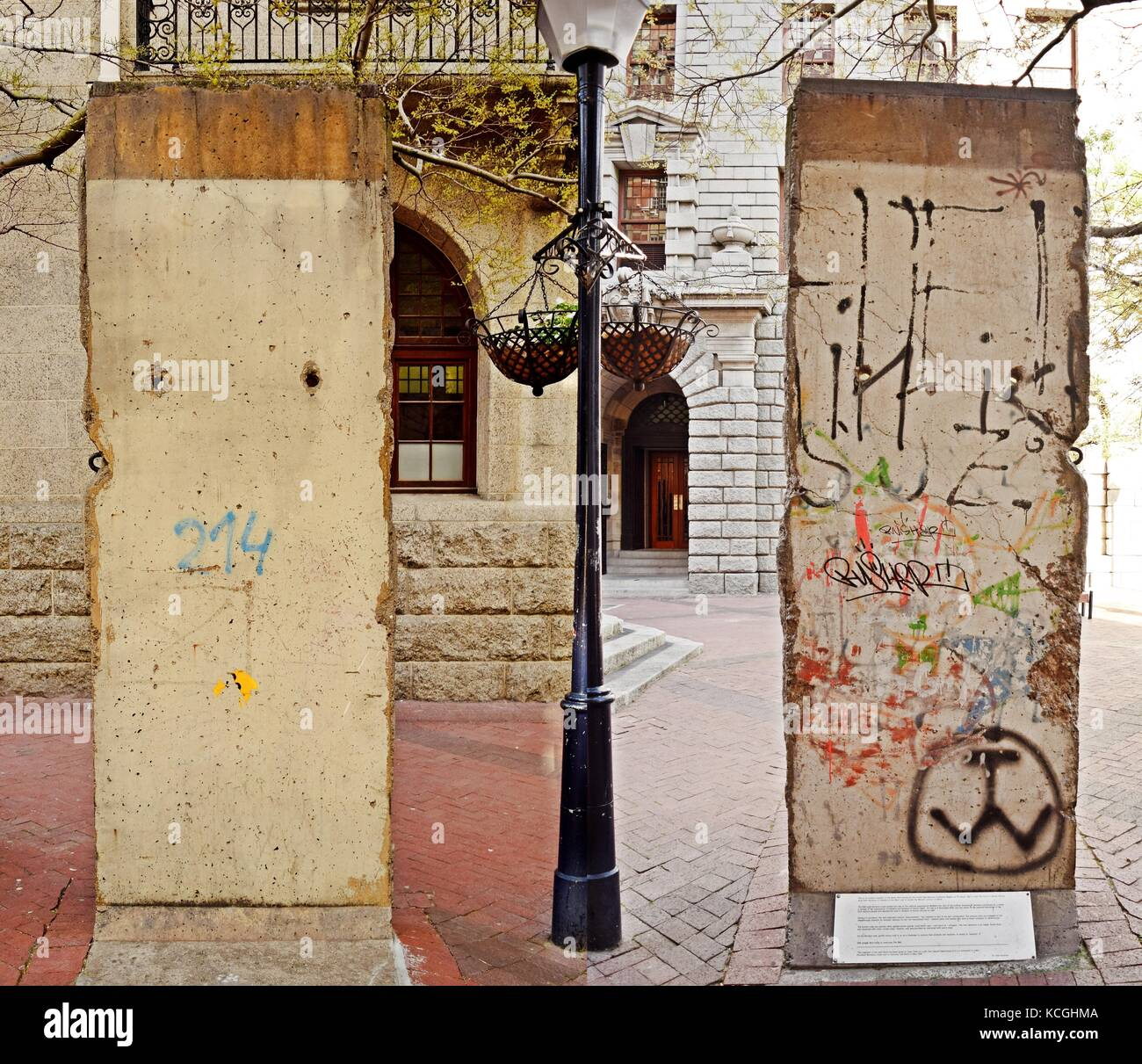 A concrete slab of the Berlin Wall, as a monument in Cape Town. The two sides of the slab show the sides of East - Stock Image