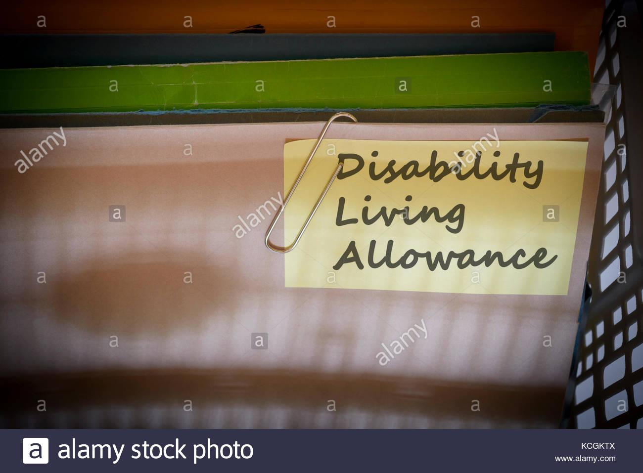 Disability Living Allowance written on document folder, Dorset, England. - Stock Image